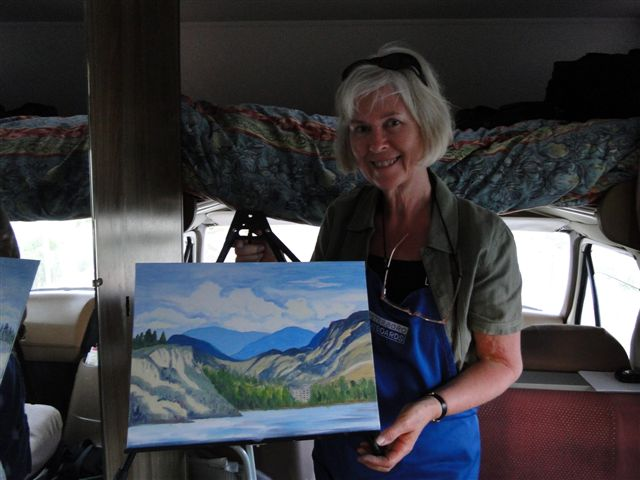 Nel Witteman painting in Motorhome on a rainy day