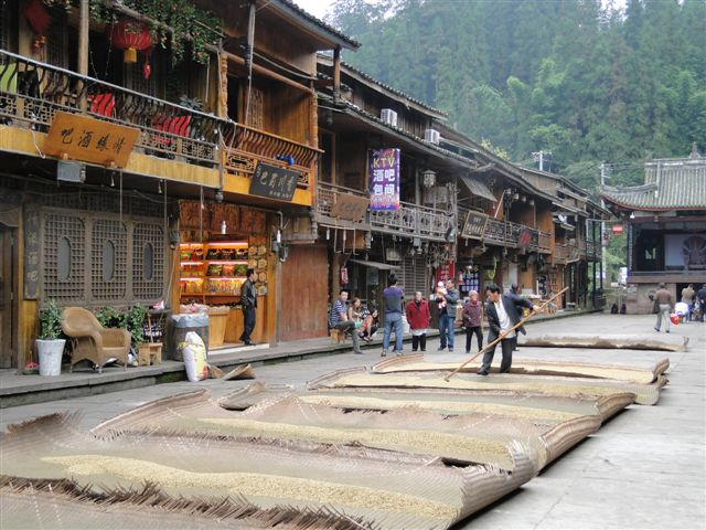 Centre of ancient town of Shangli drying grain