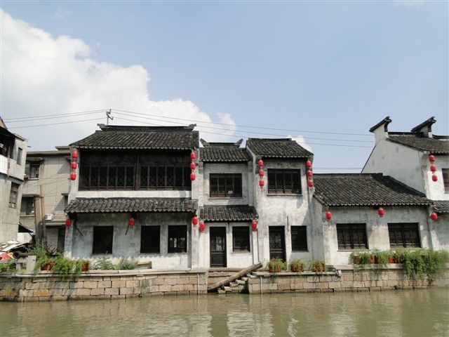 White washes houses along canal in Wuxi China