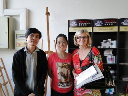 Angie McIntosh                                                   meeting head product                                                   designer for Phoenix                                                   Art Supply at factory                                                   in Wuxi China