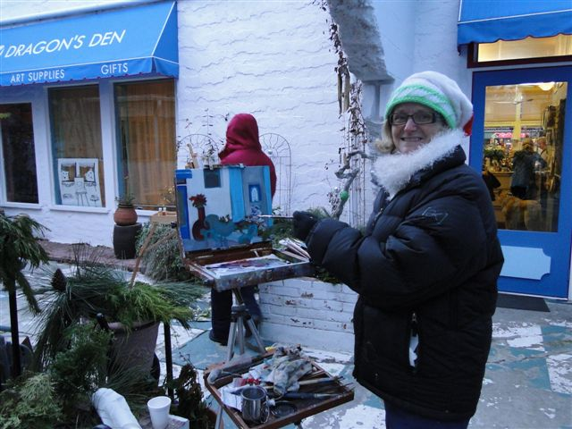 Angie Painting in December at the Dragons Den courtyard Penticton BC Canada
