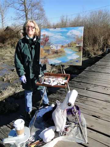 Angie with her large                                           plein air oil of Finn Slough