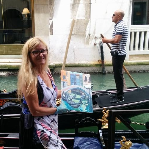 Angie                                                   McIntosh painting in                                                   Venice